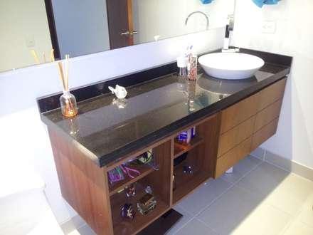 APTO. SIERRAS DEL ESTE - BOGOTA COLOMBIA: Baños de estilo moderno por MS - CONSTRUCCIONES MARIO SOTO & Cìa S.A.S.