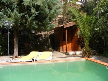Quinta de Cadafaz: Piscinas rústicas por Quinta de Cadafaz