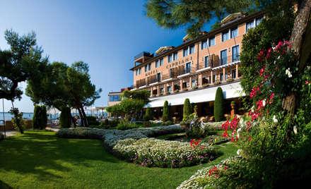 Hoteles de estilo  por Frontera Giardini