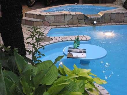 プール: 株式会社 t2・アーキテクトデザイン 一級建築士事務所が手掛けたプールです。