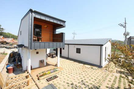 ㄷ자형 중정주택: 주택설계전문 디자인그룹 홈스타일토토의  주택
