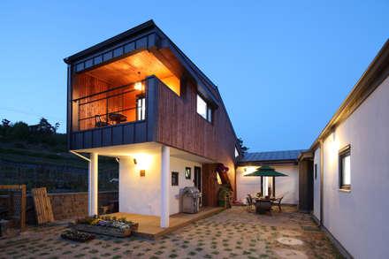 화성 봉가리주택 야경: 주택설계전문 디자인그룹 홈스타일토토의  주택