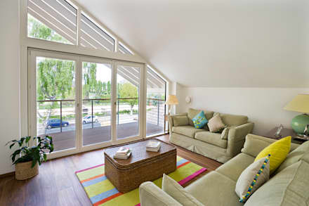 Living room: modern Living room by Baufritz (UK) Ltd.