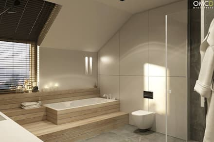 N.M. House: styl , w kategorii Łazienka zaprojektowany przez OMCD Architects