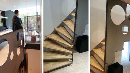 En toute discrétion...: Couloir et hall d'entrée de style  par VORTEX atelier d'architecture
