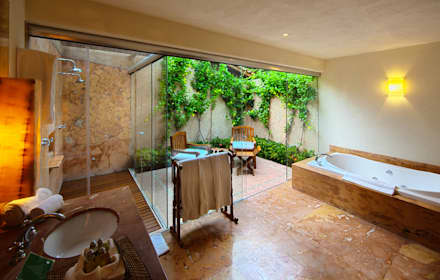 Baños de estilo topical por José Vigil Arquitectos