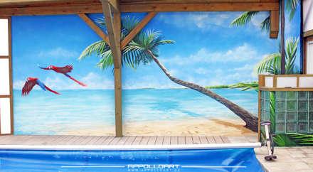 Urlaubsfeeling im Sauna Spa Bereich durch Wandkunst verschönert: tropischer Pool von  Wandgestaltung Graffiti Airbrush von Appolloart