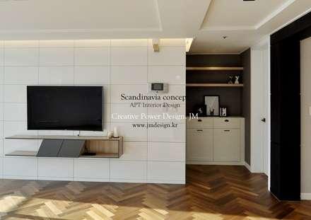 우만동 월드메르디앙 39평: JMdesign 의  거실