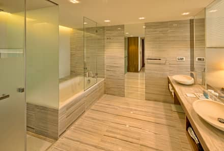Epic Sana Lisboa Hotel: Casas de banho modernas por NL Decoração