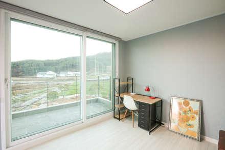 아이가 행복한 전원주택 [경남 거제도 지세포리]: 한글주택(주)의  침실
