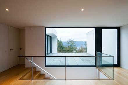 House in Barcelos, Portugal:  Terrace by Rui Grazina Architecture + Design