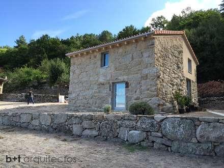 Exterior  reformado: Casas de estilo rural de b+t arquitectos