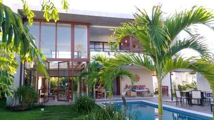 Casas de estilo topical por Tânia Póvoa Arquitetura e Decoração