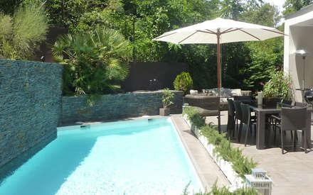 Vivir junto al Parc de Collserola: Piscinas de estilo moderno de Arquitectura Interior 88