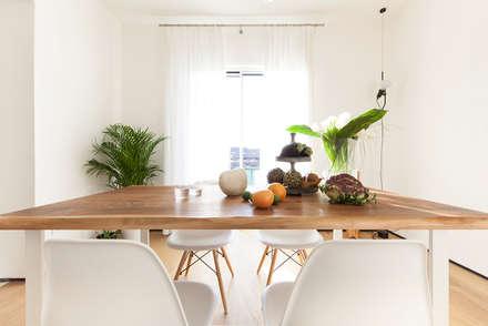 Interior DM: Sala da pranzo in stile in stile Minimalista di Didonè Comacchio Architects