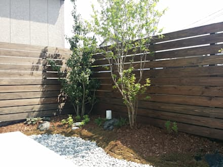 雑木が映えるモダンEXTERIOR: 株式会社 砂土居造園/SUNADOI LANDSCAPEが手掛けた庭です。