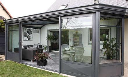 veranda: Maisons de style de style Moderne par MDR createur d'espace