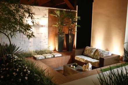 Residência Cruz: Jardins modernos por Arquitetura Ao Cubo LTDA