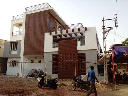 Dr varia residence: modern Houses by Tameer studio