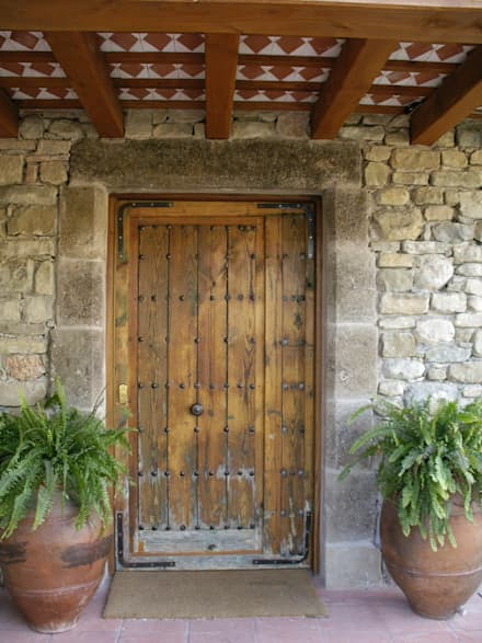 Wooden doors by Atres Arquitectes