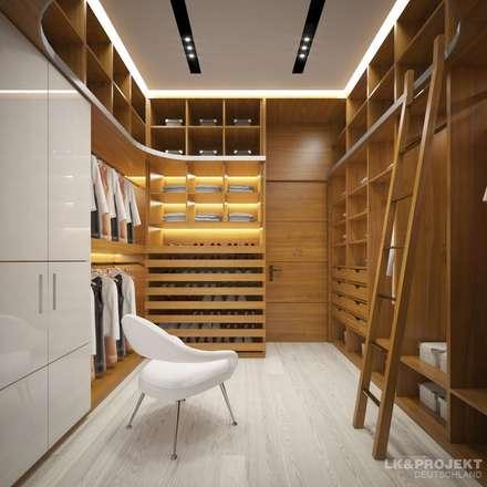 Wohnzimmer, Küche, Schlafzimmer, Bad; Garderobe, Swimmingpool, Sauna - nicht nur die Aussicht ist fantastisch... : moderne Ankleidezimmer von LK&Projekt GmbH