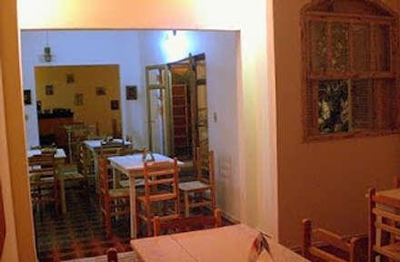 Restaurante Orange: Comedores de estilo rústico por AnnitaBunita.com