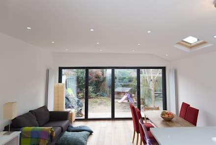 Big beautiful doors in your open plan space: modern Dining room by The Market Design & Build