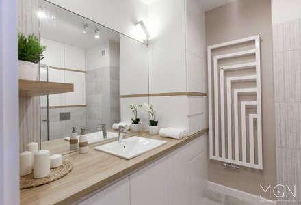 Mieszkanie 52m2: styl , w kategorii Łazienka zaprojektowany przez MGN Pracownia Architektoniczna