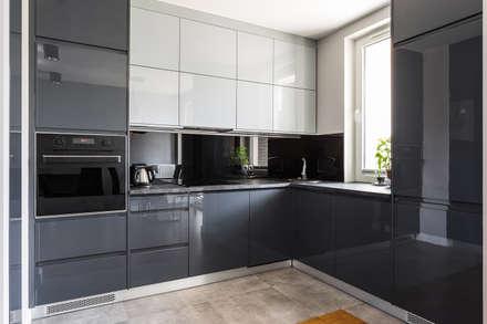 Praski apartament: styl , w kategorii Kuchnia zaprojektowany przez Michał Młynarczyk Fotograf Wnętrz