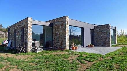 Vivienda en Bustelo: Casas de estilo moderno de AD+ arquitectura