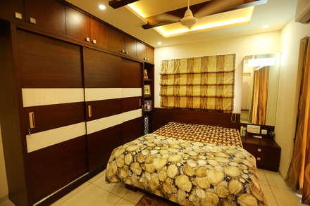 Phòng ngủ by Ashpra Interiors