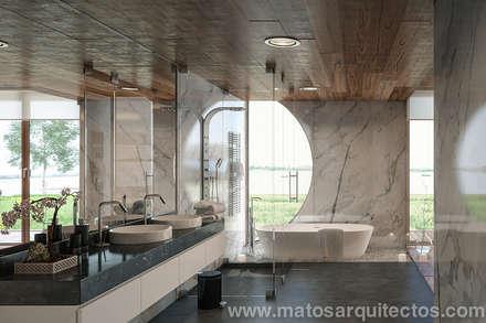 House by River side: Casas de banho modernas por Matos Architects