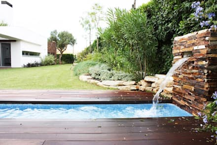 house in Vilamoura golf: Jardins modernos por Matos Architects