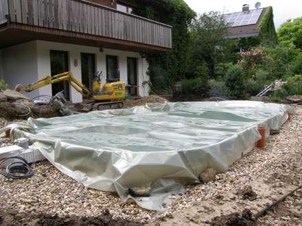 Galaarbeiten bis an den Beckenrand: mediterraner Garten von Hesselbach GmbH