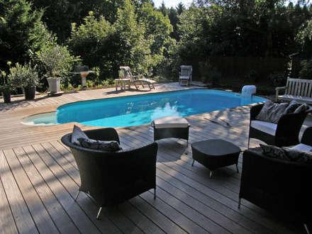 Fertigstellung des Stahlwandpools: mediterraner Garten von Hesselbach GmbH