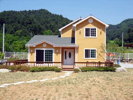 목조주택 파사드: Timber house의  주택