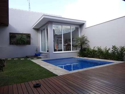 Gimnasios domésticos de estilo  por canatelli arquitetura e design