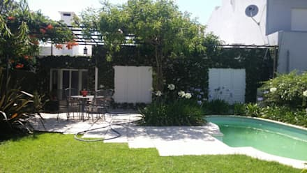JARDÍN CON PILETA: Jardines de estilo clásico por milena oitana