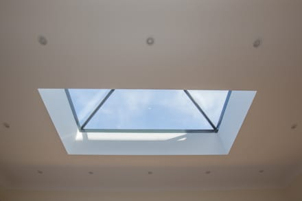 A roof window is the perfect way to fill your room with light!:  Windows  by The Market Design & Build