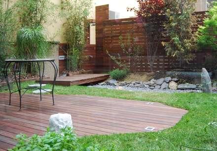 PISO EIXAMPLE: Jardines de estilo clásico de Tinda´s Project S.L.