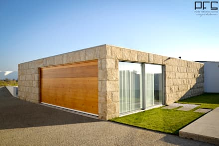 minimalistic Garage/shed by PFS-arquitectura
