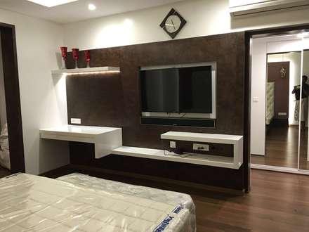 Master Bedroom TV Unit: Modern Bedroom By Studio Stimulus