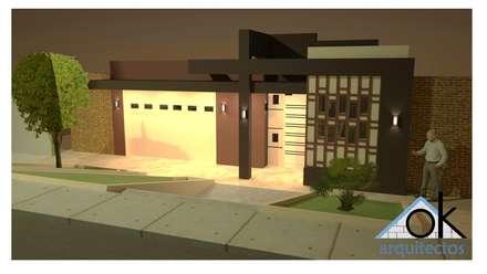 Fachadas 2 Okarq vista de noche: Casas de estilo moderno por Okarq