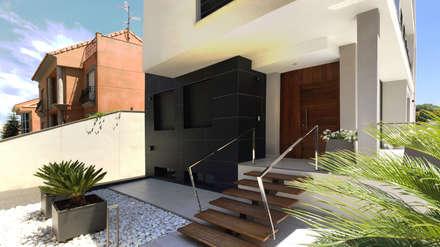 Jardin frontal (Acceso a la vivienda): Jardines de estilo moderno de arqubo arquitectos