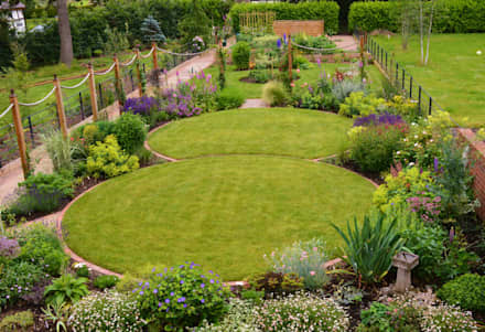 Circular lawns and traditional planting scheme: country Garden by Unique Landscapes