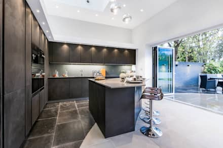 The Cooke's: modern Kitchen by Vogue Kitchens