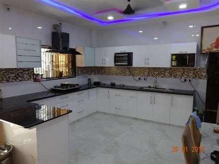 high gloss white hdf material  : modern Kitchen by aashita modular kitchen