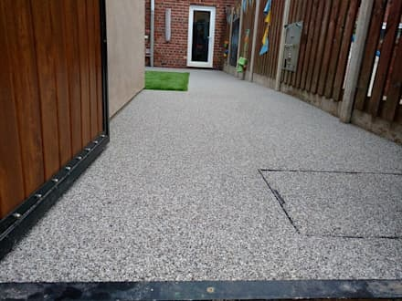 Rear garden gets a make over using resin bound paving: classic Gym by Permeable Paving Solutions UK