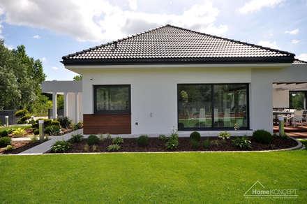 Realizacja projektu HomeKONCEPT 26: styl nowoczesne, w kategorii Domy zaprojektowany przez HomeKONCEPT   Projekty Domów Nowoczesnych