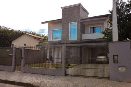 Casa RM53: Habitações  por Cecyn Arquitetura + Design